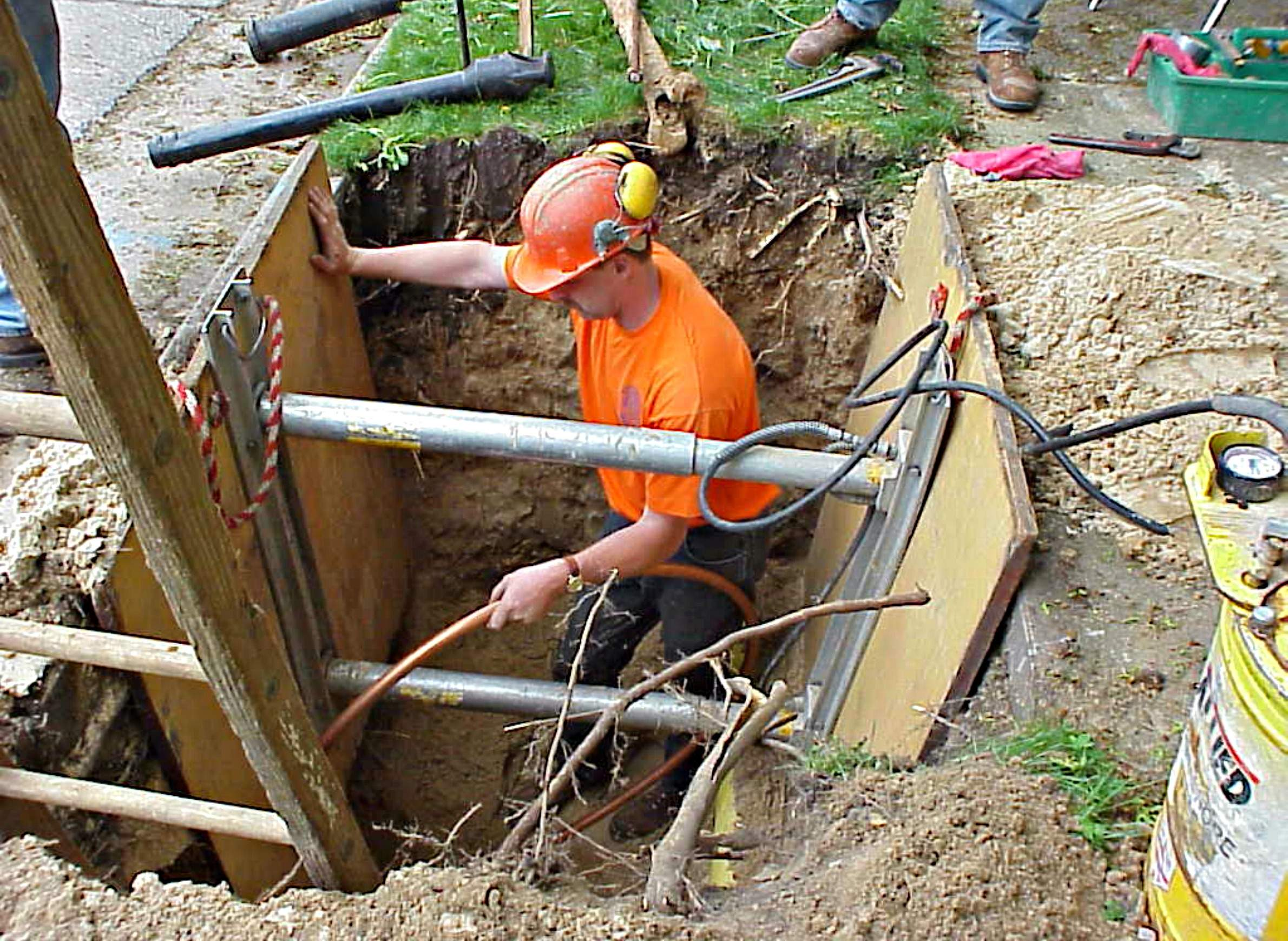 Worker replacing lead pipes in Madison & DNRu0027s Lead Pipe Program Covers Fraction Of Likely Cost   WisContext